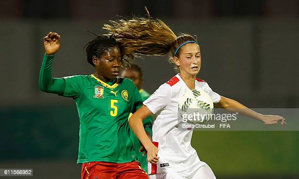 Eni Kuchambi of Cameroon challenges Jordyn Huitema of Canada during the FIFA U17 Women's World Cup Group B match between Cameroon and Canada at Al...