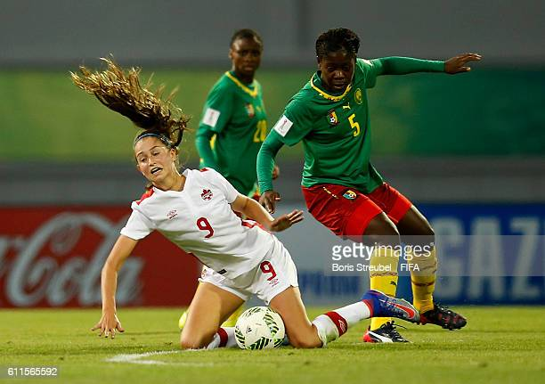 Eni Kuchambi of Cameroon tackles Jordyn Huitema of Canada during the FIFA U17 Women's World Cup Group B match between Cameroon and Canada at Al...