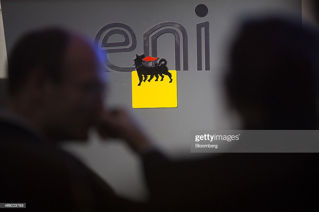A Eni SpA logo is seen during a news conference following the company's 2014-2017 strategy presentation in London, U.K., on Thursday, Feb. 13, 2014. Eni SpA, Italy's biggest oil company, said profit slumped 14 percent in the fourth quarter due to production halts in Libya and Nigeria and shrinking refining margins. Photographer: Simon Dawson/Bloomberg via Getty Images
