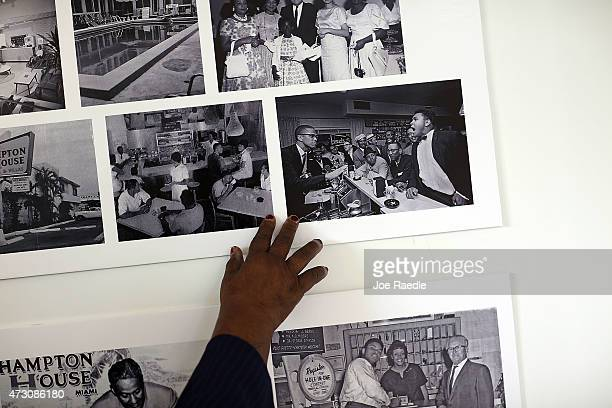 Enid Curtis Pinkney Founding President and CEO of the Historic Hampton House Community Trust points to a photograph of Malcolm X and Mohammad Ali at...