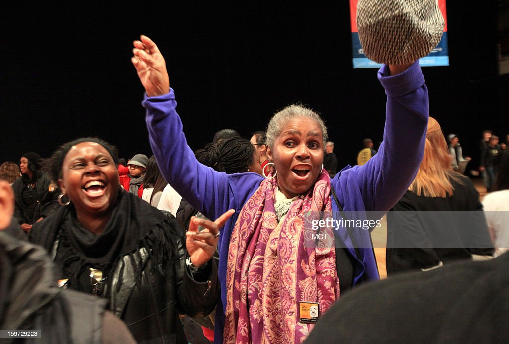 Enid Rogers, 52, of Sierra Leone, left, laughs at her friend Ellena Barnett, 66, of Washingon, D.C. as Barnett dances during the MLK National Day of Service at the Washington Armory in Washington, D.C, Saturday, January 19, 2013. Thousands of volunteers danced and assembled nearly 100,000 care kits filled with necessities for deployed U.S. service members, Wounded Warriors, veterans and first responders. The service project was part of the 57th Presidential Inauguration.