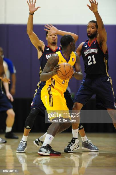 Eniel Polynice of the Los Angeles DFenders drives against Mustapha Farrakhan and Damian Johnson of the Bakersfield Jam during a game at Toyota Sports...