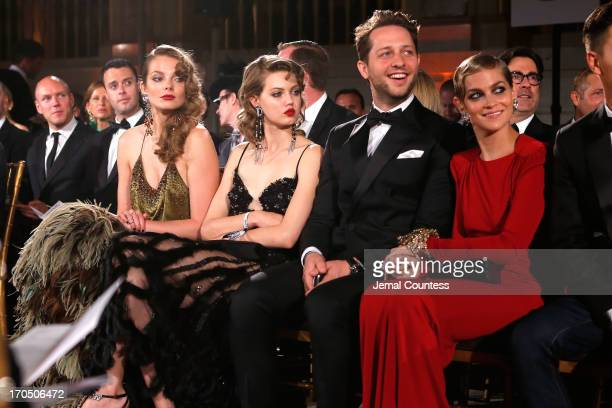 Eniko Mihalik Lindsey Wixson Derek Blasberg and Leigh Lezark watch the runway during the 4th Annual amfAR Inspiration Gala New York at The Plaza...