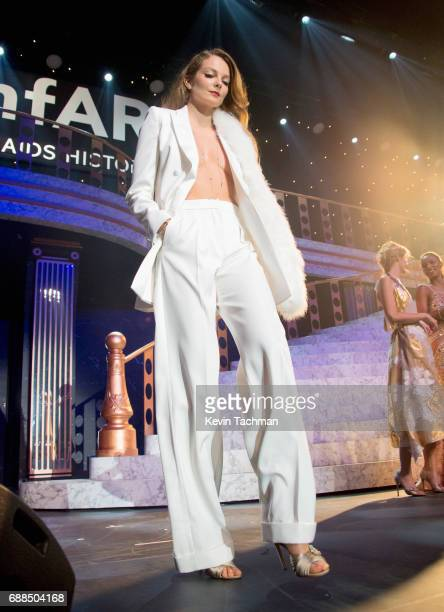 Eniko Mihalik walks the runway at the amfAR Gala Cannes 2017 at Hotel du CapEdenRoc on May 25 2017 in Cap d'Antibes France