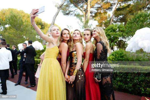 Eniko MihalikHana JirickovaHannah Ferguson and a guest take a selfie during the amfAR Gala Cannes 2017 at Hotel du CapEdenRoc on May 25 2017 in Cap...