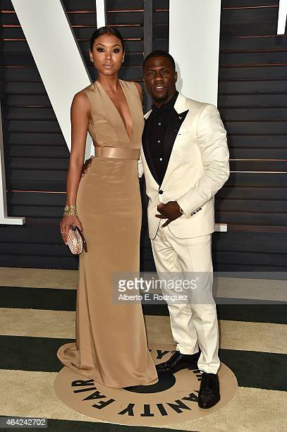 Eniko Parrish actor Kevin Hart attend the 2015 Vanity Fair Oscar Party hosted by Graydon Carter at Wallis Annenberg Center for the Performing Arts on...