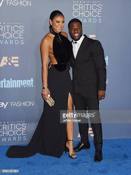 Eniko Parrish and comedian Kevin Hart arrive at The 22nd Annual Critics' Choice Awards at Barker Hangar on December 11 2016 in Santa Monica California