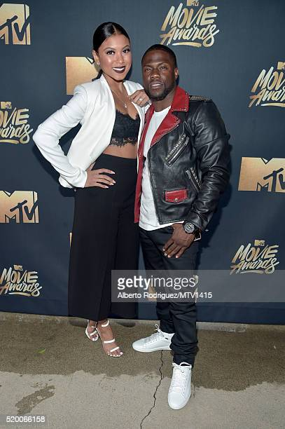 Eniko Parrish and Host Kevin Hart attend the 2016 MTV Movie Awards at Warner Bros Studios on April 9 2016 in Burbank California MTV Movie Awards airs...