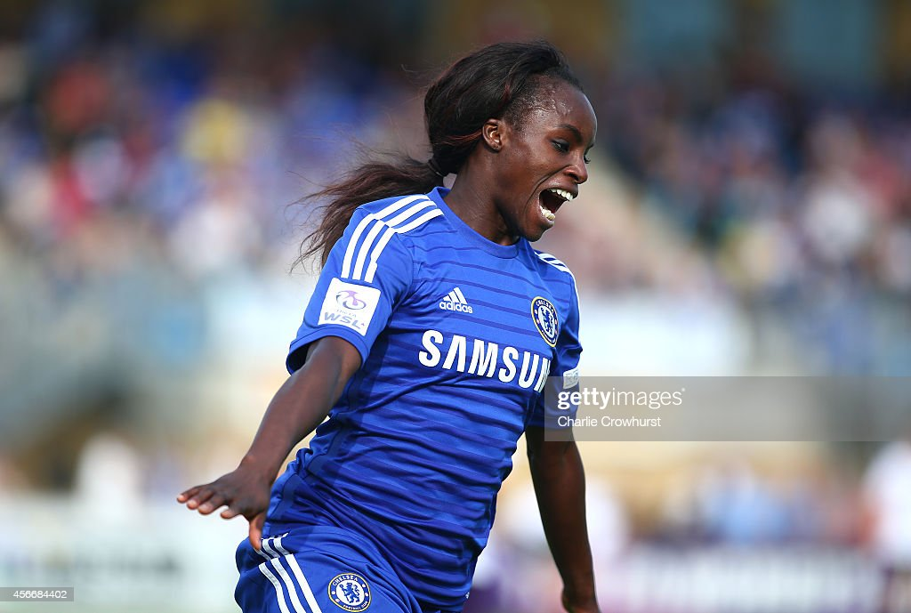 Eniola Aluko of Chelsea celebrates after scoring her first goal and the teams second during the FA WSL match between Chelsea Ladies and Everton Ladies at Wheatsheaf Park on October 5, 2014 in Staines, England.