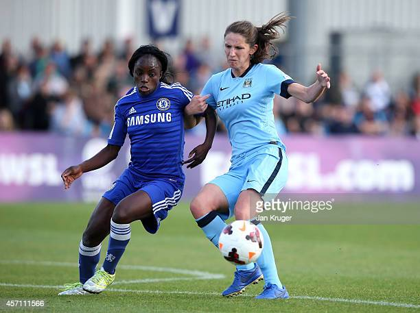 Eniola Aluko of Chelsea Ladies battles with Laura Bassett of Manchester City Women during the WSL match between Manchester City Women and Chelsea...