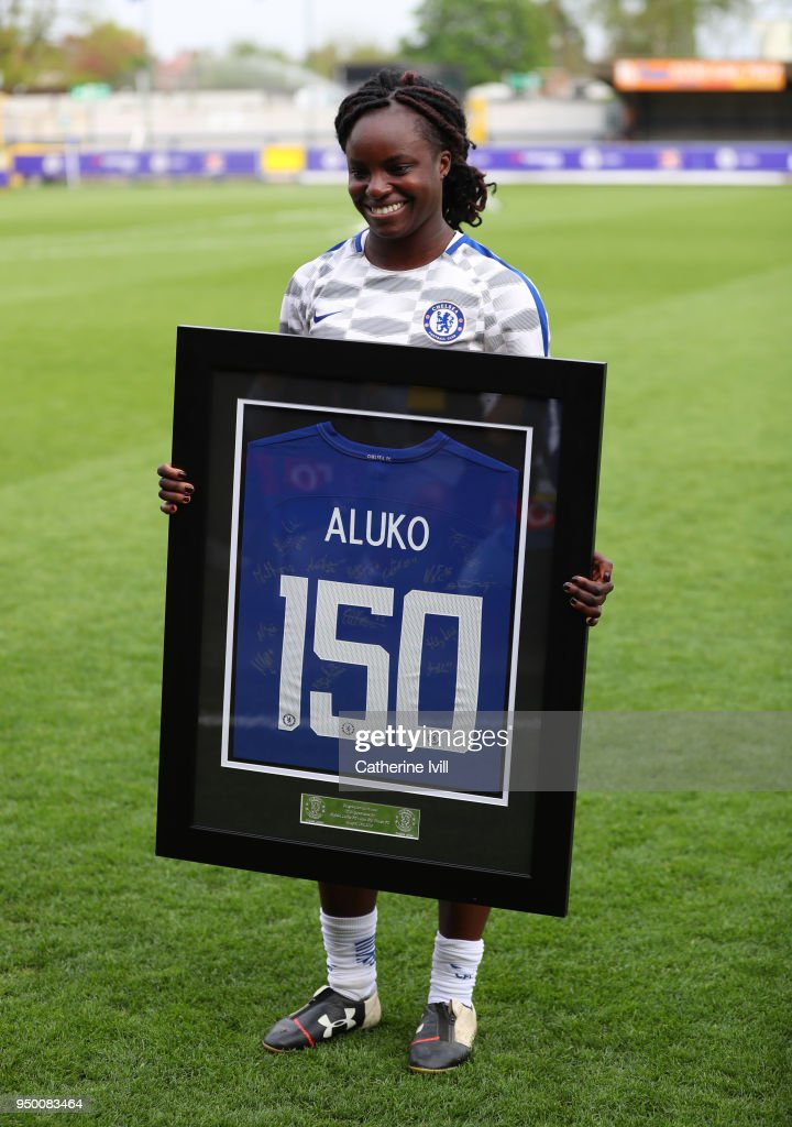 Eniola Aluko of Chelsea receives a shirt to commemorate 150 appearances before the UEFA Womens Champions League Semi-Final: First Leg between Chelsea Ladies and Wolfsburg at The Cherry Red Records Stadium on April 22, 2018 in Kingston upon Thames, England.