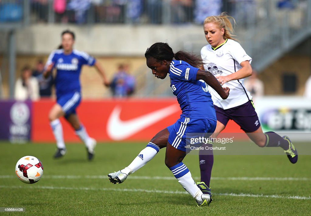 Eniola Aluko of Chelsea scores her first goal and the teams second during the FA WSL match between Chelsea Ladies and Everton Ladies at Wheatsheaf Park on October 5, 2014 in Staines, England.