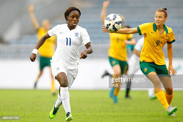 Eniola Aluko of England and Caitlin Foord of Australia compete for the ball in the match between England and Australia during the 2015 Yongchuan...