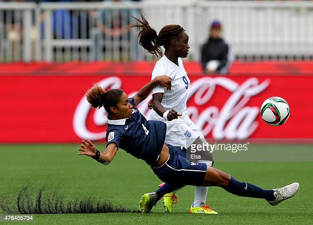 Eniola Aluko of England and Laura Georges of France fight for the ball during the FIFA Women's World Cup 2015 Group F match at Moncton Stadium on...