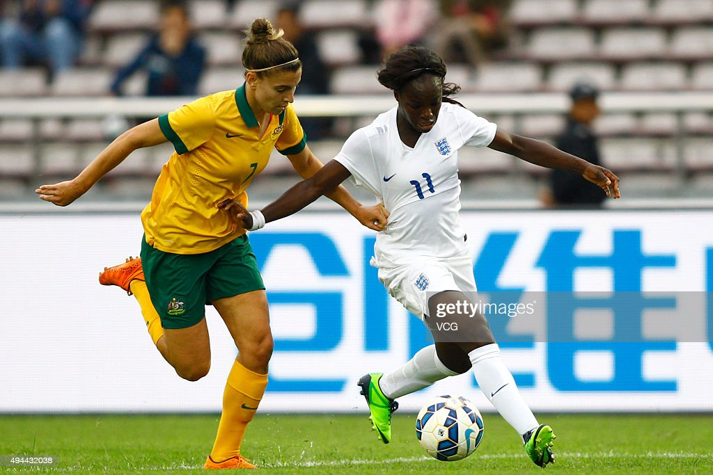Eniola Aluko #11 of England and Stephanie Catley #7 of Australia compete for the ball in the match between England and Australia during the 2015 Yongchuan Women's Football International Matches at Yongchuan Sports Center on October 27, 2015 in Yongchuan, Chongqing of China.