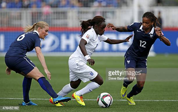 Eniola Aluko of England challenges for the ball with Amandine Henry and Elodie Thomis of France during the FIFA Women's World Cup 2015 Group F match...