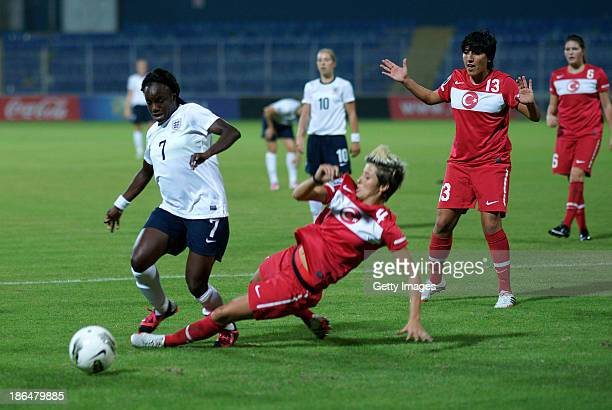Eniola Aluko of England is challenged by Esra Erol of Turkey during the FIFA Women's World Cup 2015 Group 6 Qualifier between Turkey and England on...