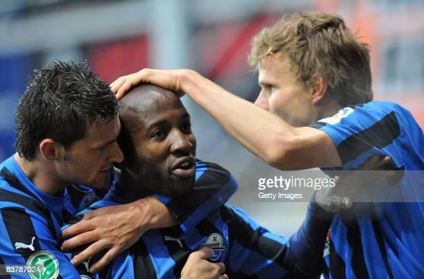 Enis Alushi Dominick Kumbela and Sebastian Schuppan of Paderborn celebrate after the the 3 Bundesliga match between SC Paderborn and VFR Aalen at the...
