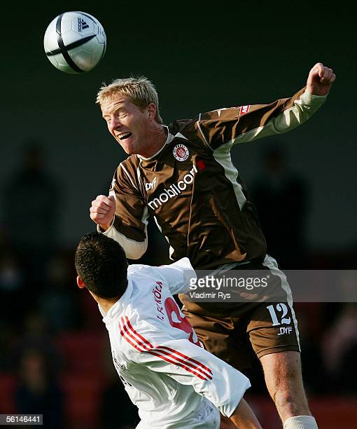 Enis Alushi of Cologne and Timo Schultz of Pauli vie for a header during their third Bundesliga match between 1 FC Cologne and FC St Pauli at the...