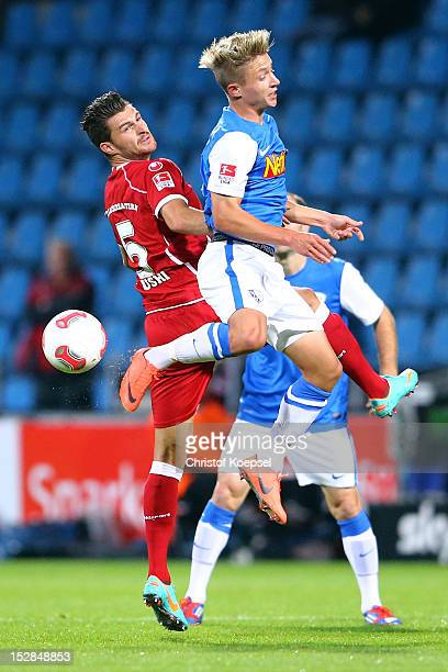 Enis Alushi of Kaiserslautern and Marc Rzatkowski of Bochum go up for a header during the Second Bundesliga match betweeen VfL Bochum and 1 FC...