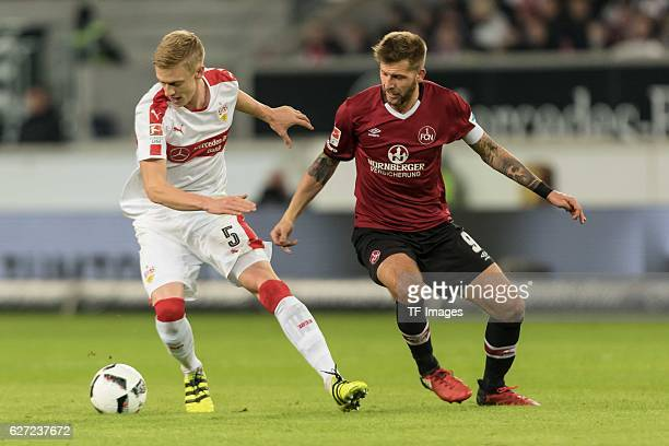 Enis Alushi of Nuernberg and Guido Burgstaller of Nuernberg battle for the ball during the second Bundesliga match between VfB Stuttgart and 1 FC...