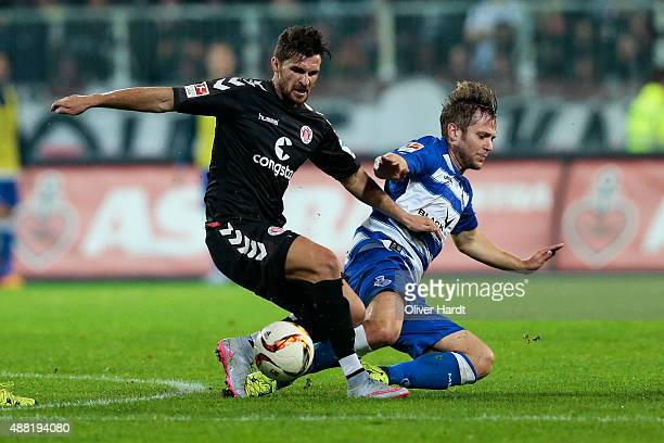 Enis Alushi of Pauli and Martin Dausch of Duisburg compete for the ball during the Second Bundesliga match between FC St Pauli and MSV Duisburg at...
