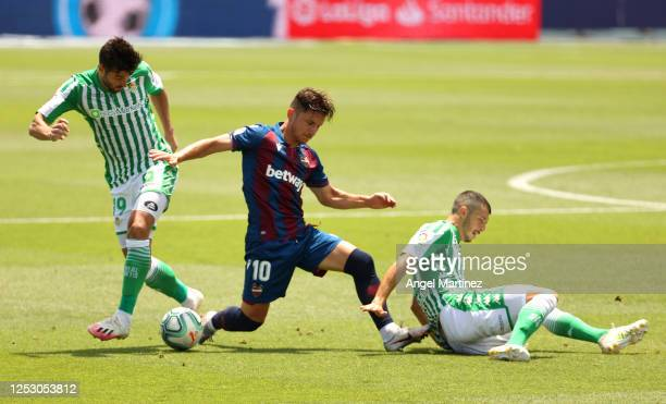 Enis Bardhi of Levante UD battles for possession during the La Liga match between Levante UD and Real Betis Balompie at Estadi Olimpic Camilo Cano on...