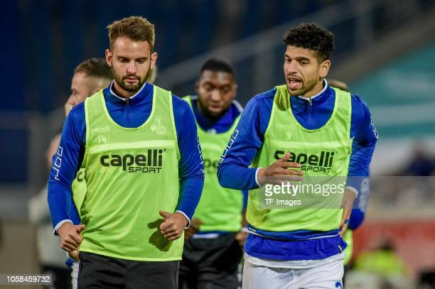 Enis Hajri of MSV Duisburg and Tim Albutat of MSV Duisburg look on prior the Second Bundesliga match between MSV Duisburg and FC St Pauli at...