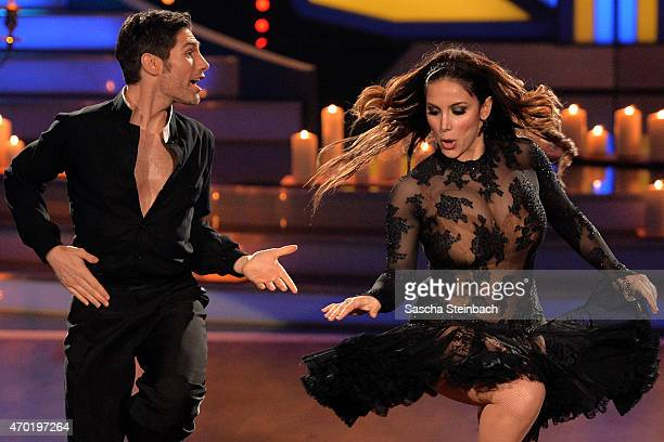 Enissa Amani and Chirstian Polanc perform on stage during the 5th show of the television competition 'Let's Dance' on April 17 2015 in Cologne Germany