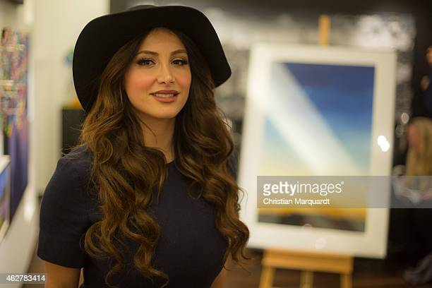 Enissa Amani attends a press conference at Galerie Mensing on February 5, 2015 in Berlin, Germany. Majesty Farah Diba Pahlavi is in Berlin to present...