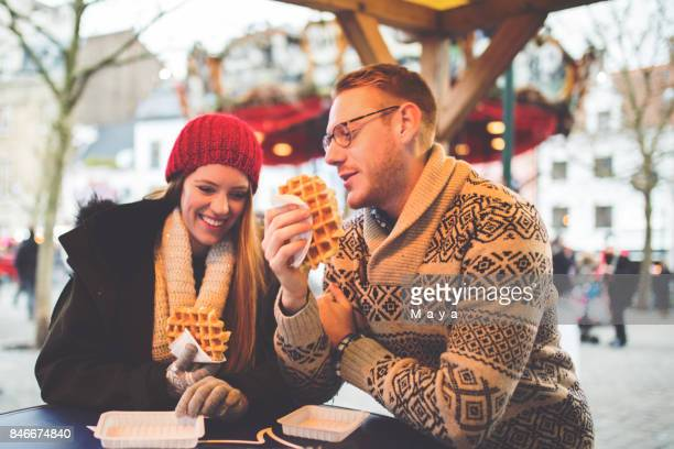 enjoy eating waffles - brussels capital region stock pictures, royalty-free photos & images