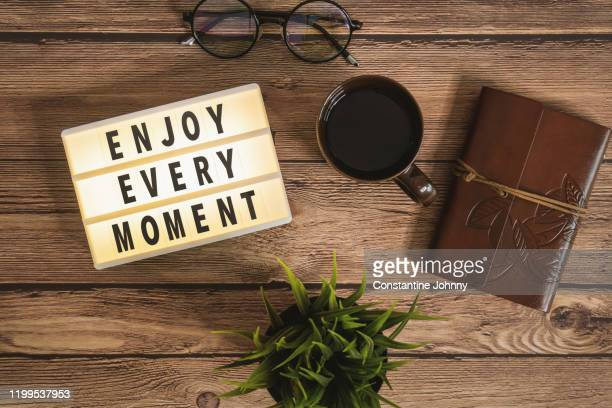 enjoy every moment message in light box over rustic wood - thanks quotes stock pictures, royalty-free photos & images