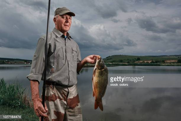 enjoy his hobby - fisherman stock pictures, royalty-free photos & images