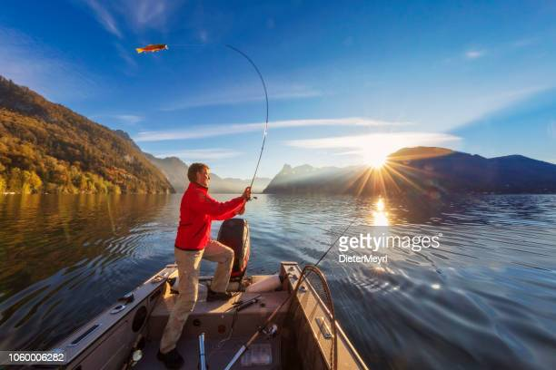enjoy my leisure time - fishing at alpin lake - upper austria stock pictures, royalty-free photos & images