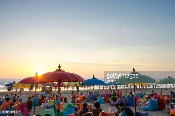 enjoy sunset at seminyak (kuta and legian), bali - indonesia - bali fotografías e imágenes de stock