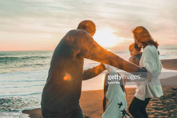 enjoy sunset beach - kyonntra stock pictures, royalty-free photos & images