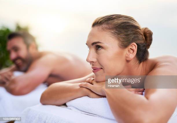 enjoy the good life - husband massage wife stock photos and pictures