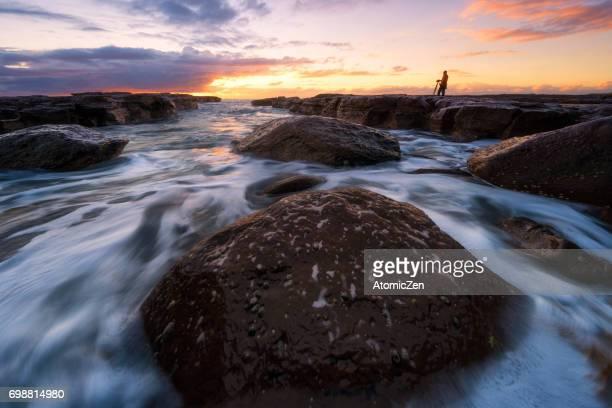 Enjoy the rising sun at Kiama surf beach, South of Sydney, Australia