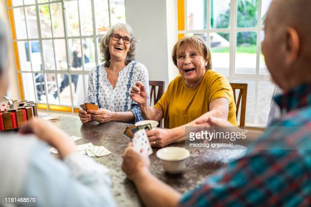 enjoyable card game with friends - retirement community stock pictures, royalty-free photos & images