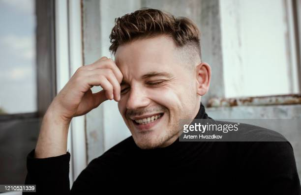 enjoyful smiling young man with stylish under cut hairstyle - eastern european descent stock pictures, royalty-free photos & images