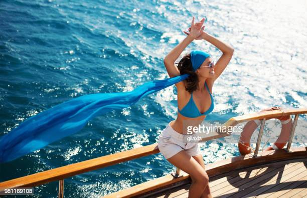 enjoying a boat cruise. - hot women on boats stock pictures, royalty-free photos & images