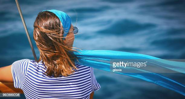 enjoying a boat cruise. - scarf stock pictures, royalty-free photos & images