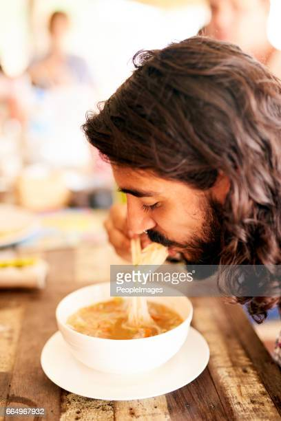Enjoying a bowl full of noodles