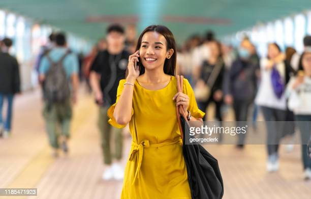 enjoying a call while commuting - approaching stock pictures, royalty-free photos & images