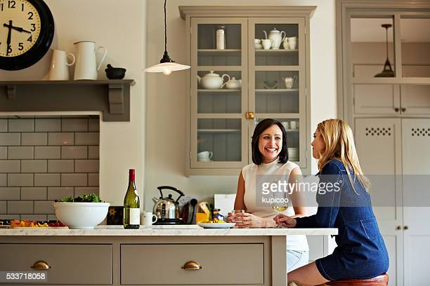 enjoying a chat in the kitchen - catching stock pictures, royalty-free photos & images