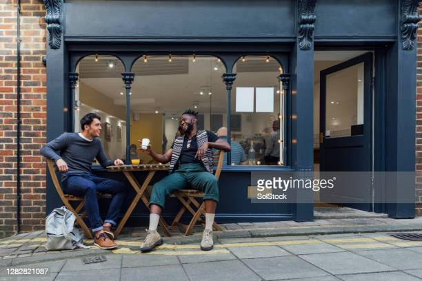 enjoying a coffee together - internet cafe stock pictures, royalty-free photos & images