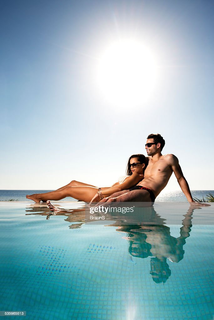 Enjoying a day at the pool. : Stock Photo