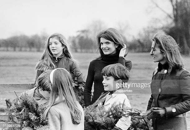 Enjoying a day's outing at the Henley home of Princess Lee Radziwill are her sister Jacqueline Onassis and their children Anna Radziwill John Kennedy...