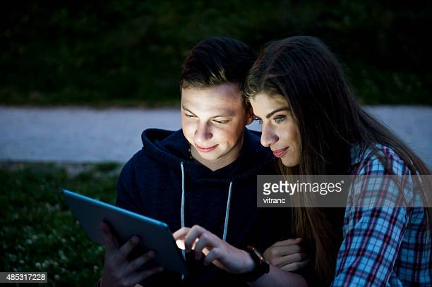 Enjoying a evening with digital tablet