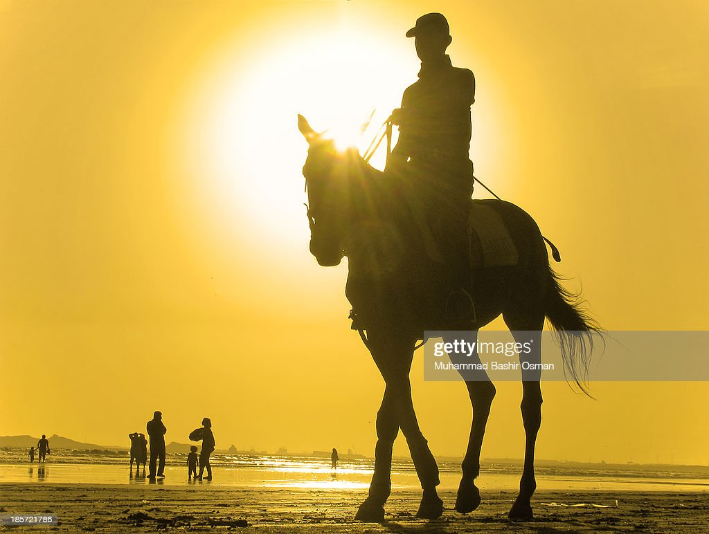 A POLO PLAYER AND THE SUNSET : News Photo